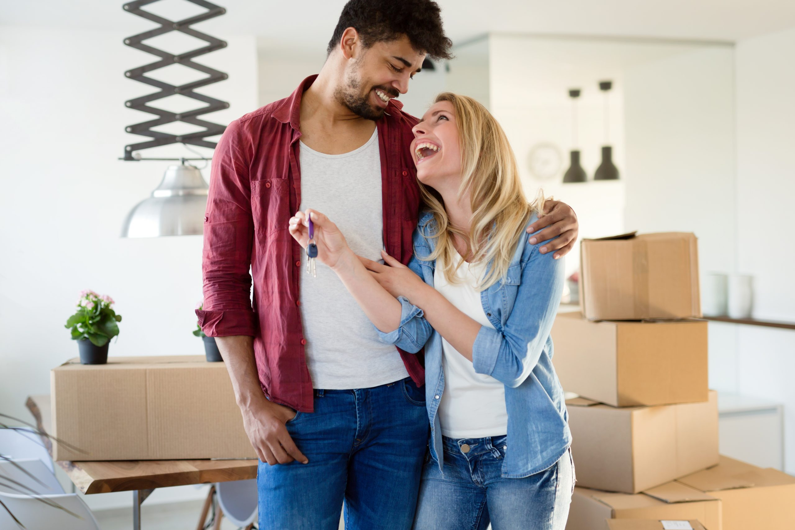 Image of happy couple moving into a house symbolizing your ideal customers or target audience