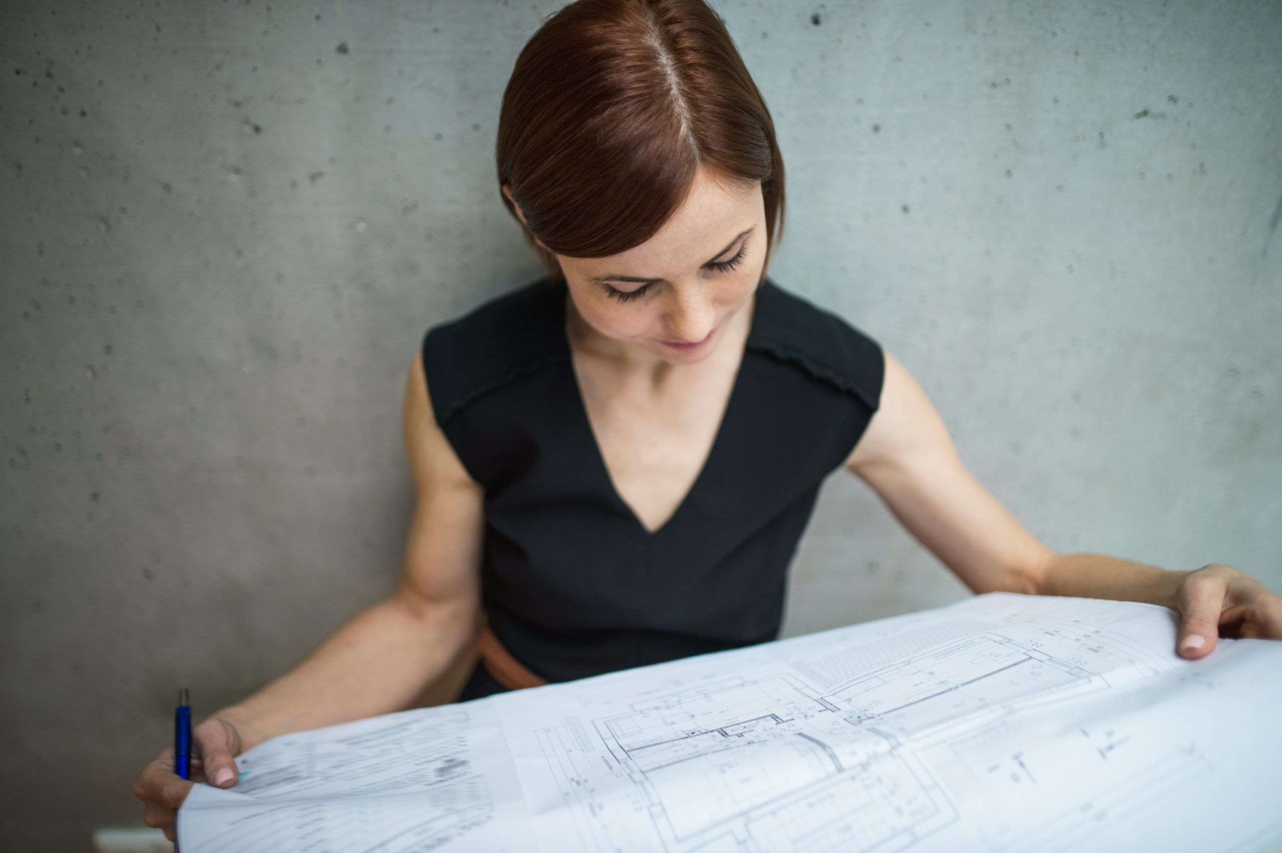 image of a businesswoman looking at a marketing blueprint