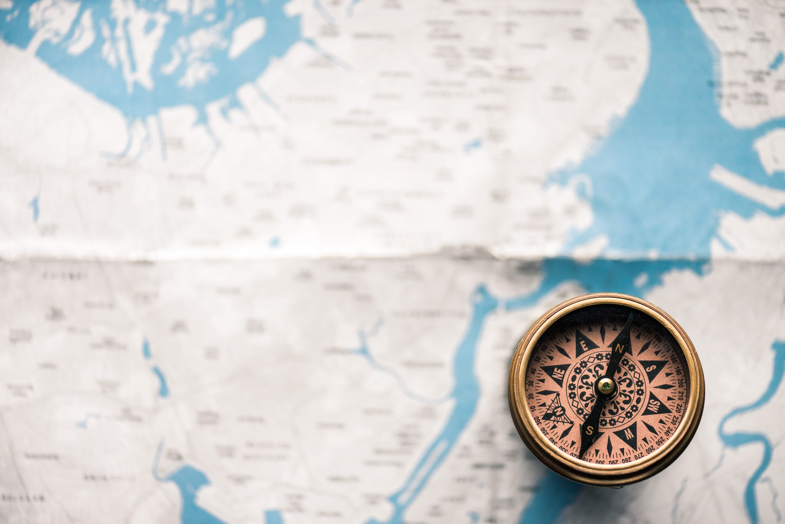 image of a compass and map symbolizing mapping the customer journey