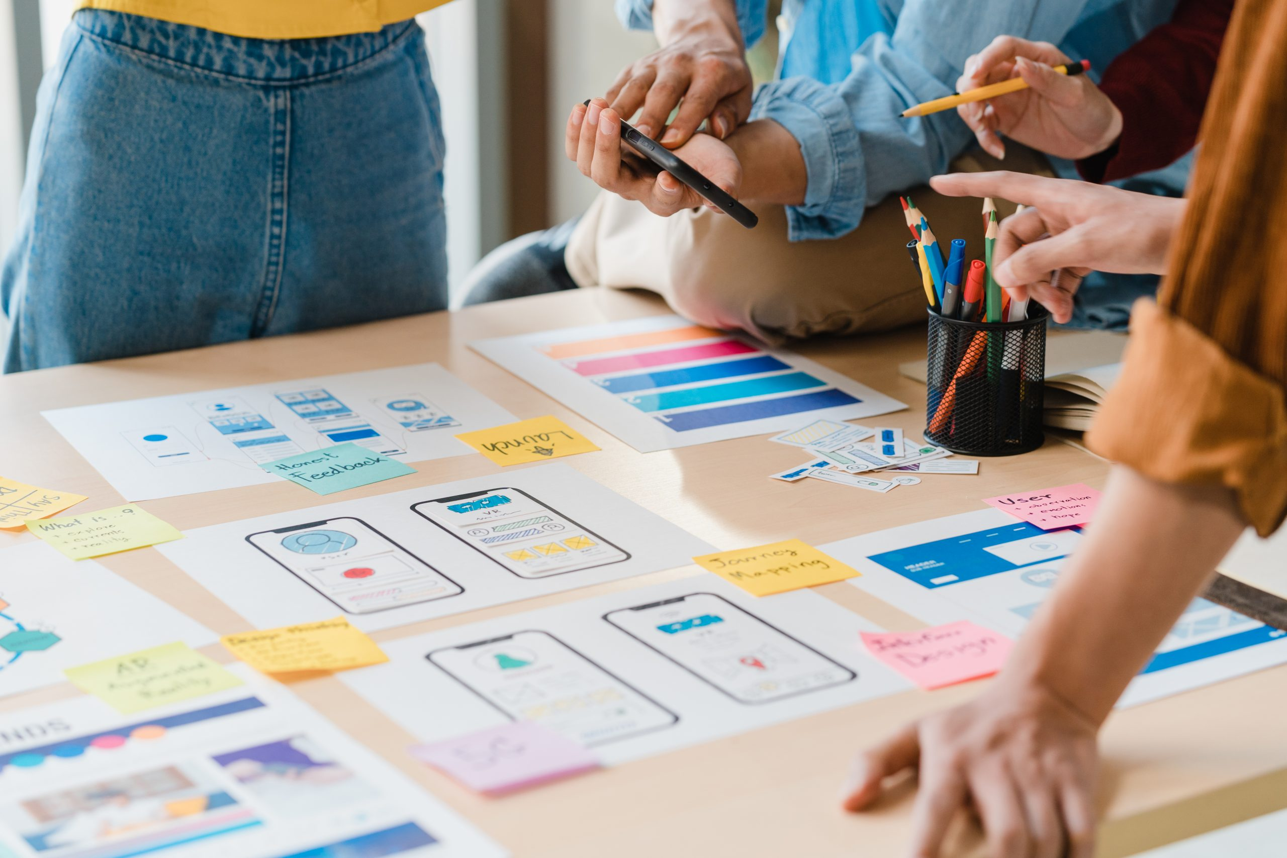 Image of people reviewing brand and part of a business mid-year marketing checklist