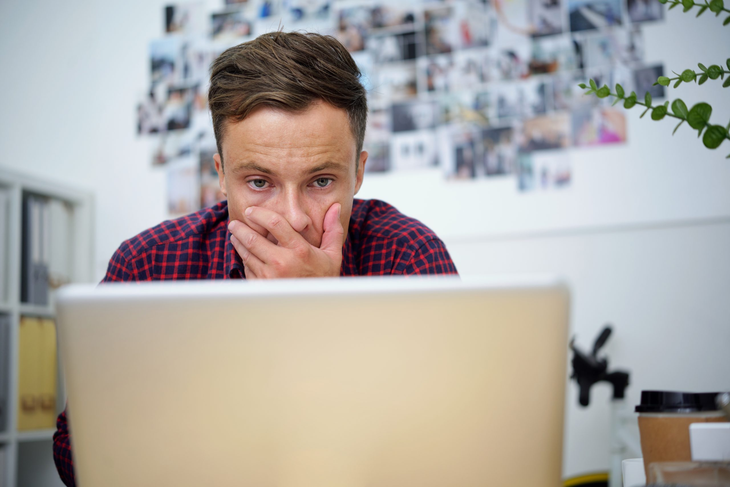 Image of a man looking frustrated worried about his business