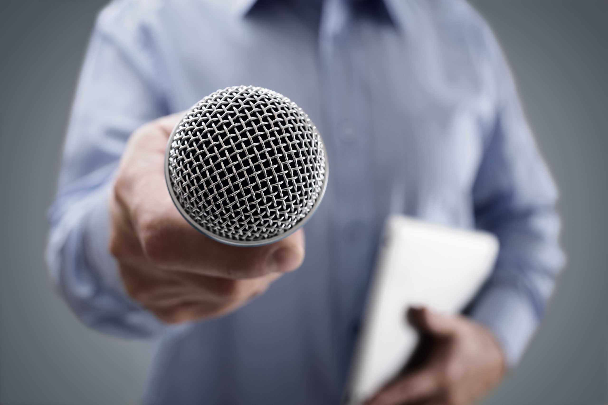 photo of microphone representing asking your prospects questions to get better marketing results
