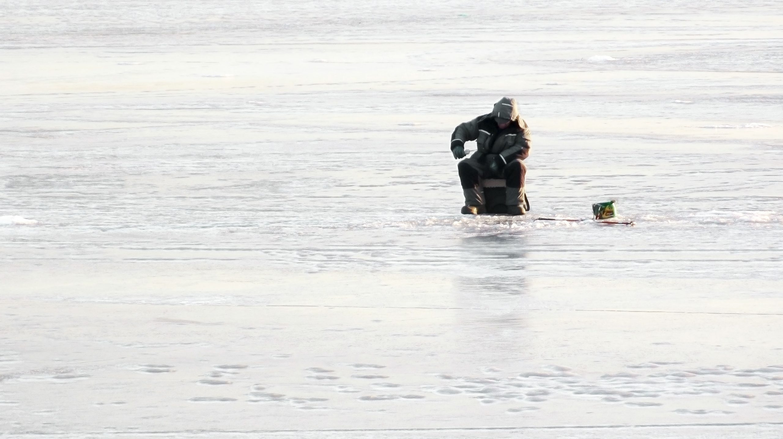 Image of man ice fishing indicating ideal duration in marketing campaigns